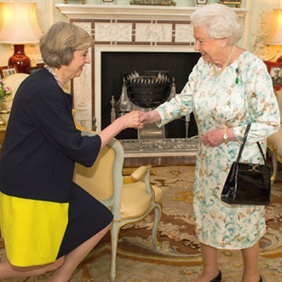 Theresa May with HM the Queen